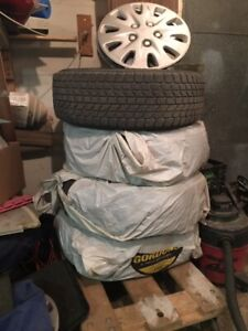 SNOW TIRES , 4 , ON RIMS ,USED