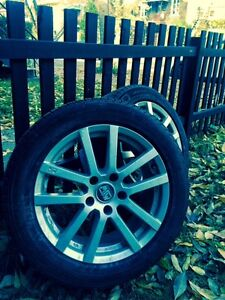 4 pneus Michelin X-ICE 215/55/17 montés sur mags