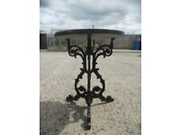 antique garden table base cast iron with granite top .In excellent condition