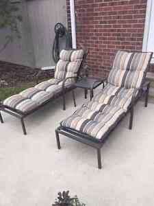 2 Patio loungers with cushions and table