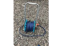 Garden hose including reel and extra parts