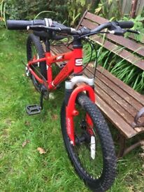"Kids red bike with suspension and gears. 20"" wheel. Good condition"