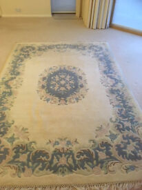 Beautiful cream woollen rug with pastel coloured pattern