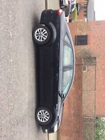 Ford Mondeo Black 2.0 TDCi Zetec Powershift 5dr (2011) with private hire taxi plated