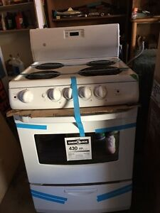 "GE & Frigidaire 24"" New White Stoves"