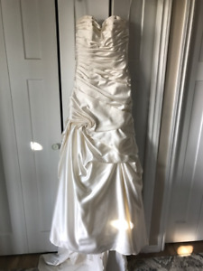 Elegance Bridal Collection, size 6 altered to fit size 4.