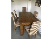 Oak wood extending dining table with 6 chairs - 4 year old