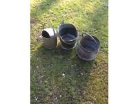 collection of coal scuttles , watering can