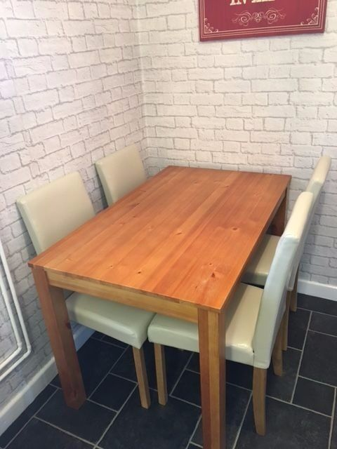 Oak Effect dining table and 4 midback cream leather chairs 120cm table 6 mths oldcost249 argosin Southmead, BristolGumtree - I have a oak effect dining table and chairs, 120cm table in length, chairs are cream leather, they are mid back, never really used, but table has some light surface marks as shown in pics, these are either side on the corners, not sure why, apart...