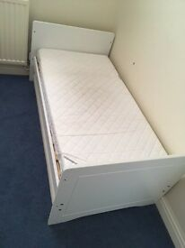 Child's bed with mattress.