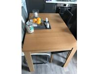Extending Dining Table with 4 Black Chairs