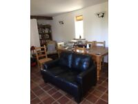 Black leather sofa in excellent condition