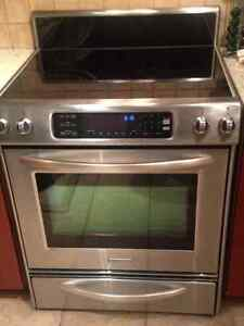 Stainless steel Kitchenaid Stive and GE fridge