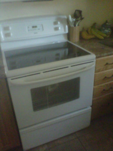 KENMORE WHITE STOVE AND SIDE BY SIDE FRIG