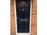 Navy blue front door with frame