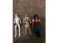 3 star wars figures, including storm trooper