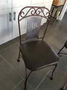 Glass top wrought iron tabale with 6 chairs/Can sell separately West Island Greater Montréal image 2