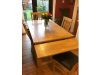 Dining room table and chairs, solid light oak no damage only light wear from use.