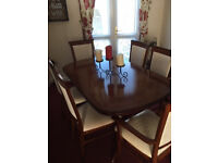 Dining Table and 6 chairs 2 of which are carvers,Mint condition,from a smoke free home