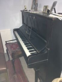 Dark wood upright piano