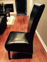A Pair Of Faux Leather Dark Brown Parsons Dining Chairs