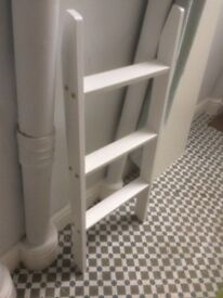 White wooden ladder and IKEA boards to giveaway