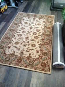 Two brand new wool rugs 5' x 8' (photo)