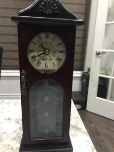 Mahogany color wooden jewelry box with clock