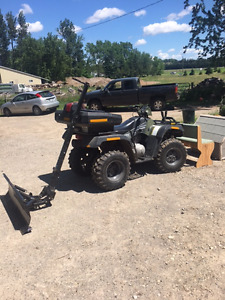 Arctic cat 4 wheeler with plow