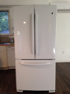 2 year old double door GE refridgerator with pull out freezer.
