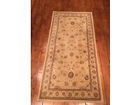 Floral patterned beige rug 160 x 80cms (noble art)