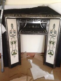 Beautiful iron and tiled fire surround.