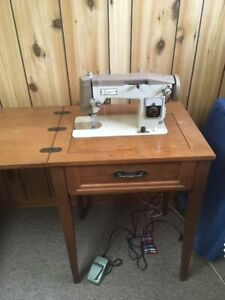 Retro Sewing Machine in Wood Cabinet