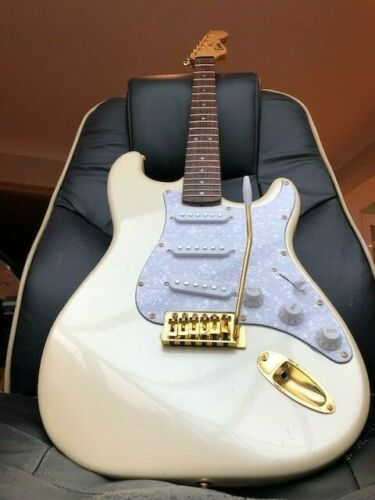 Vintage 1988 Stratocaster by Encore in Olympic Pearl with Gold Hardware.