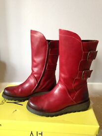 Fly London boots, size 6 and only worn once, for £115.
