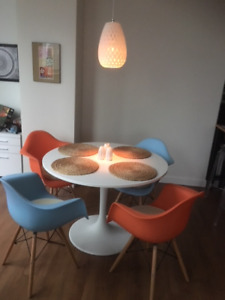 "Round Table (41"") and 4 moulded plastic Eames style chairs"