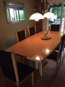 Maple dining table and chairs with hutch and china cabinet.