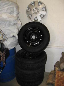 4 snow tires 225/60R/16 on rims,hub caps,very good condition