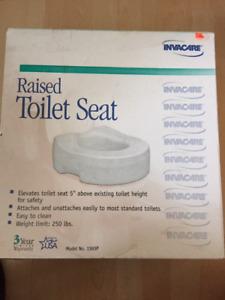 Invacare raised toilet seat
