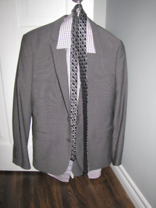 Man's size 34 grey suit, worn once!