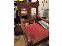 Beautiful antique carved wooden chair with arms