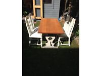 Oak top dining table with 4 chairs