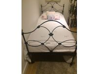 Black wrought iron and brass single bed