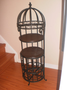 Vintage wrought iron wine cabinet with wooden shelves