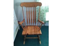Traditional wooden rocking chair perfect for nursery or lounge. £25