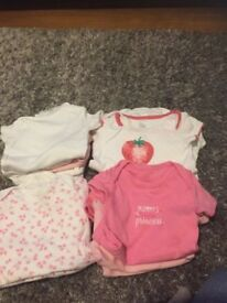Bundle of baby girls vests