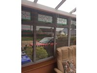 Metallic Venetian Blinds used in conservatory Terracotta and dark green