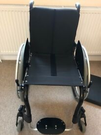 - BRAND NEW VERY VERY LIGHTWEIGHT WHEELCHAIR - ( FREE DELIVERY )
