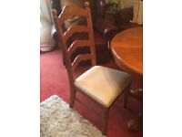Extendable dining room table with 6 chairs. Little heat mark but other then that good condition.