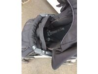 Black Pram with cosy sleeve and rain cover